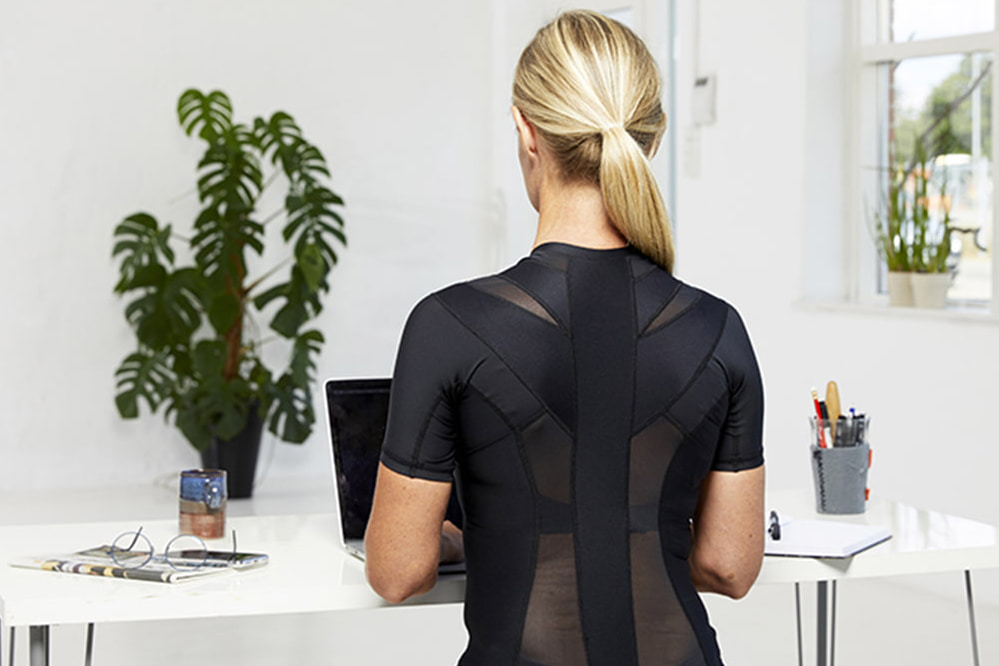 woman wearing anodyne posture shirt